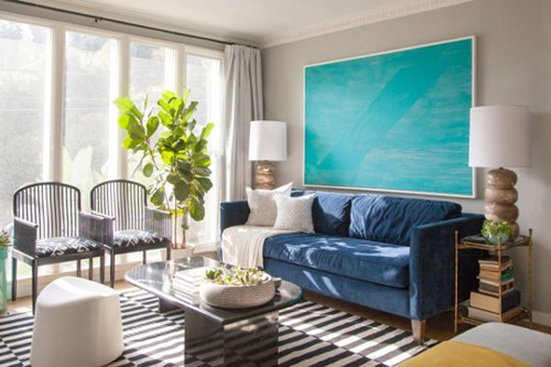 Trang trí tranh khổ lớn làm tăng thêm sức hấp dẫn cho ngôi nhà